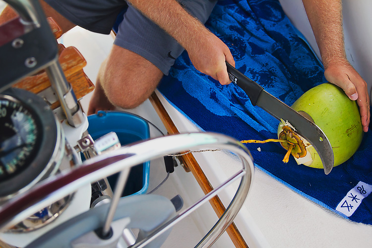 Sailing-Blog-Cruising-Bahamas-Caribbean-Liveaboard-LAHOWIND-Young-Couple-Boat-Dog-Coconuts-Machete-Coconut-Milk-eIMG_6395